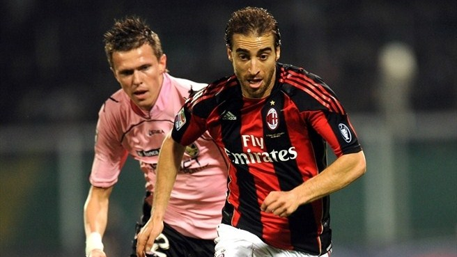 Milan's Flamini to miss group stage with knee injury