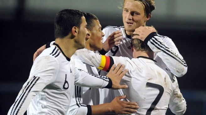 Germany and spirited Montenegro win through