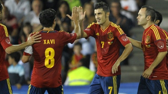 Torres and Villa mark Spain milestones in style