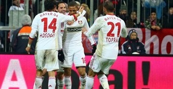 Leverkusen's Sidney Sam is mobbed by team-mates after scoring the winner at Bayern