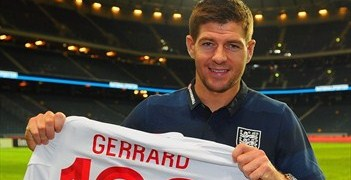 Steven Gerrard celebrates winning his 100th cap ahead of England's 4-2 defeat to Sweden at the Friends Arena