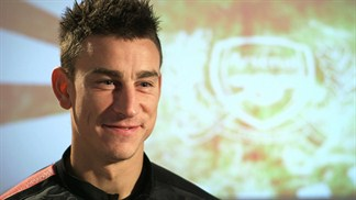 Arsenal's Koscielny keeps feet on the ground