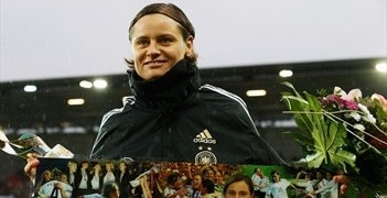 Germany forward Martina Müller receives a commemorative plaque before her final international match