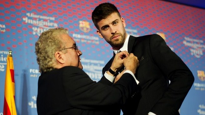 Barcelona family keeps Piqué grounded