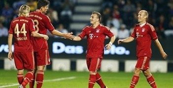 Bayern celebrate their fifth unanswered goal against Schalke in Doha today