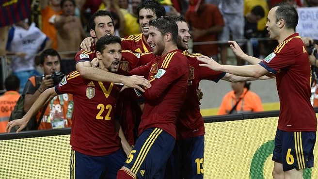 Spain hold their nerve to eliminate Italy
