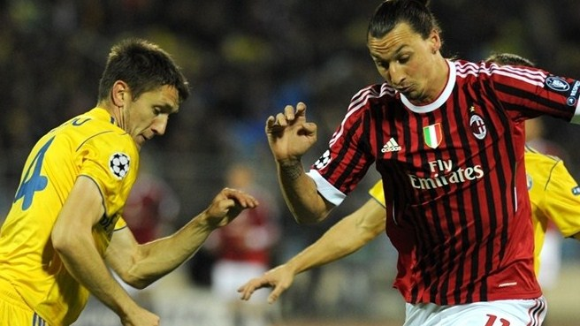 Milan through despite BATE draw