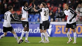 Fulham players celebrate their first goal