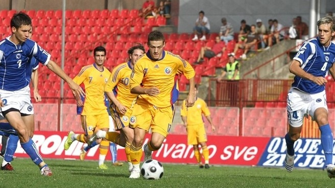 Romania falter but remain on course