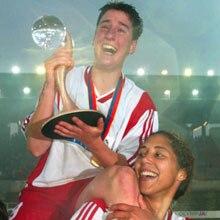 Frankfurt goalscorer Birgit Prinz holds aloft the UEFA Women's Cup