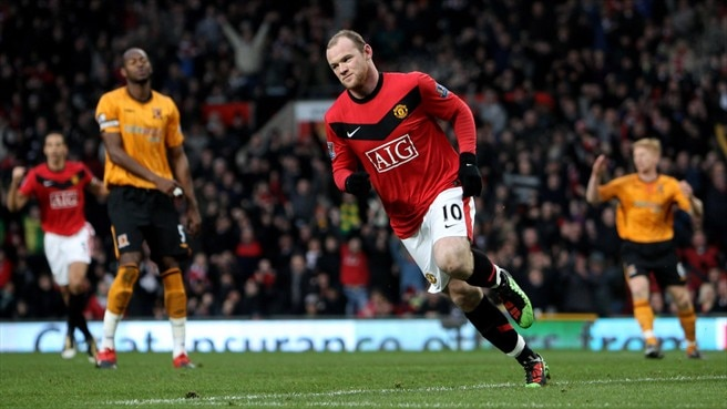 Four-goal Rooney puts United ahead