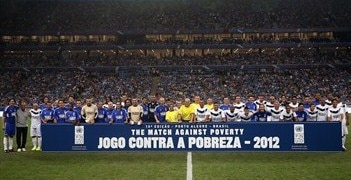 The players pose for the cameras before the game in southern Brazil