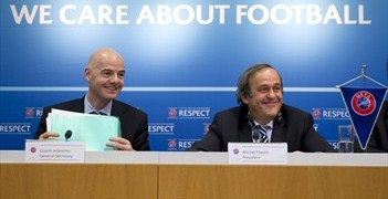 UEFA General Secretary Gianni Infantino and UEFA President Michel Platini speak to the media