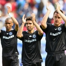 Deco (centre) applauds the Chelsea fans after his goal secured victory